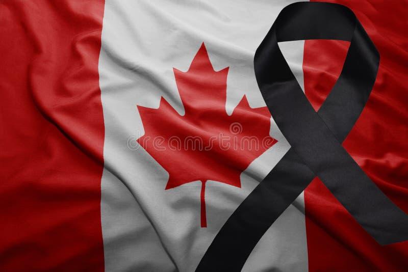 加拿大的旗子有黑哀悼的丝带的 图库摄影