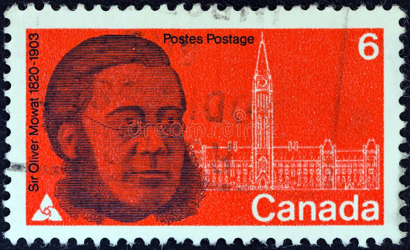 加拿大-大约1970年:在加拿大打印的邮票显示政治家奥利佛史东Mowat和议会先生,大约1970年 图库摄影