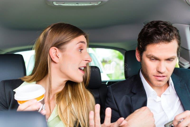 移动在出租汽车的人们,他们有一个任命 图库摄影