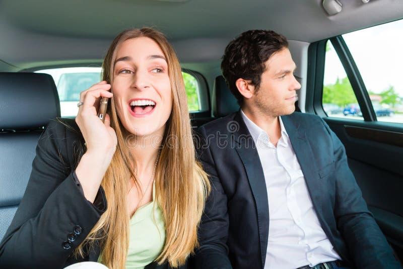 移动在出租汽车的人们,他们有一个任命 库存图片