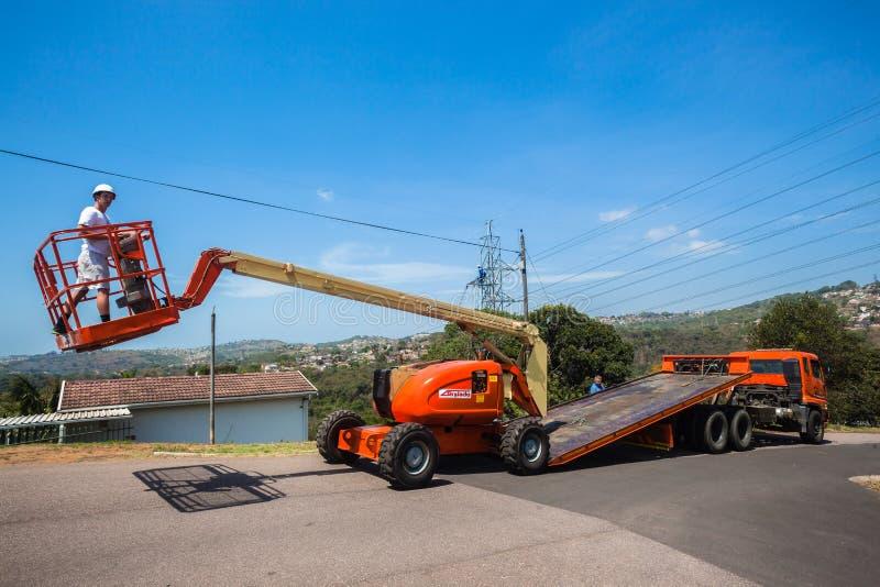 移动式起重机操作员平床卡车 图库摄影