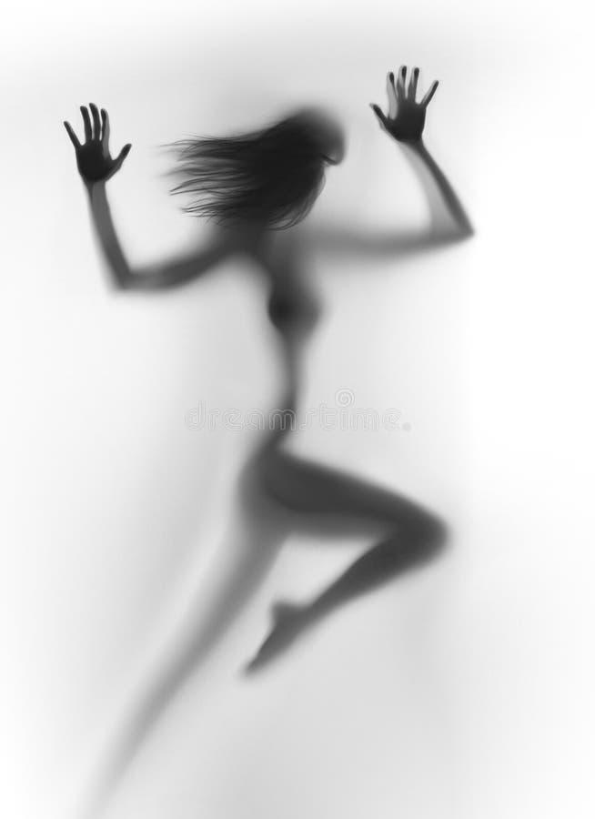 动态运动的妇女身体剪影跑,手,长的头发 免版税库存照片