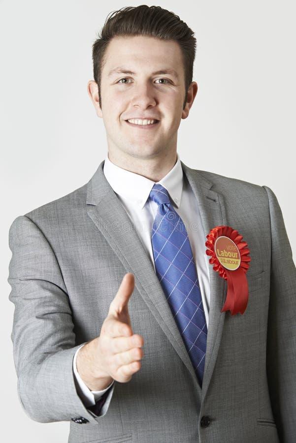 劳工党的政客画象提供援助握手 库存照片