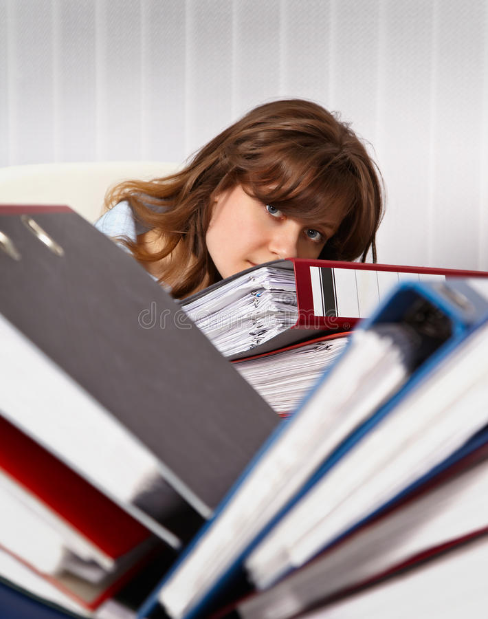 劳累过度的秘书妇女 库存图片