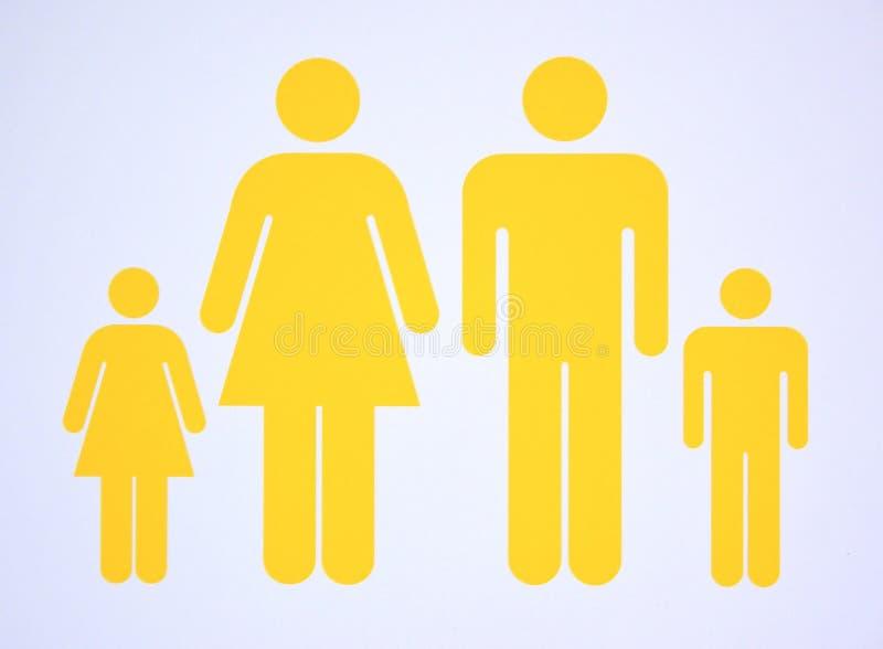 包括核心家庭的标志两个父母和两个孩子 免版税图库摄影