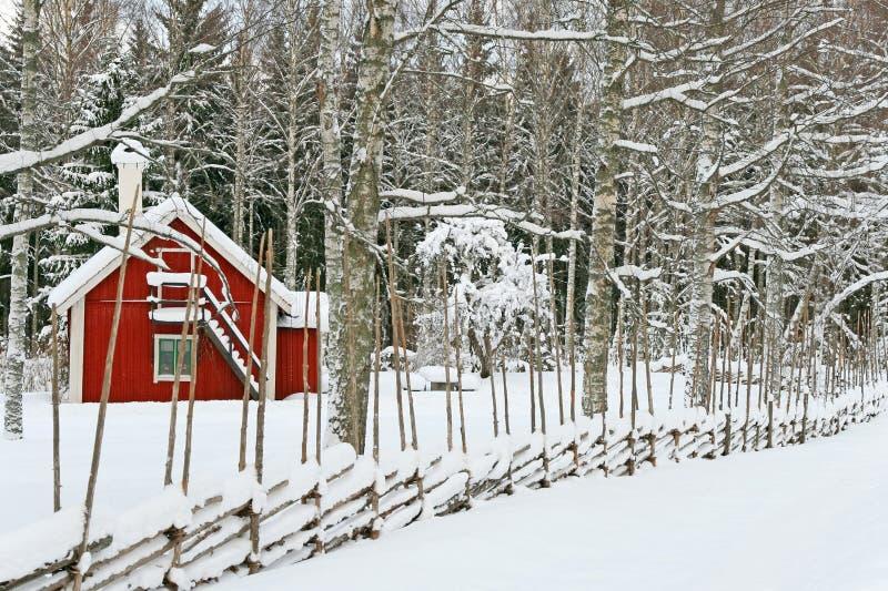 包括的房子少许红色雪 库存图片
