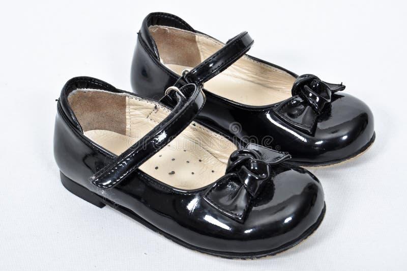 包括nubuck和皮革的女孩鞋子 免版税图库摄影