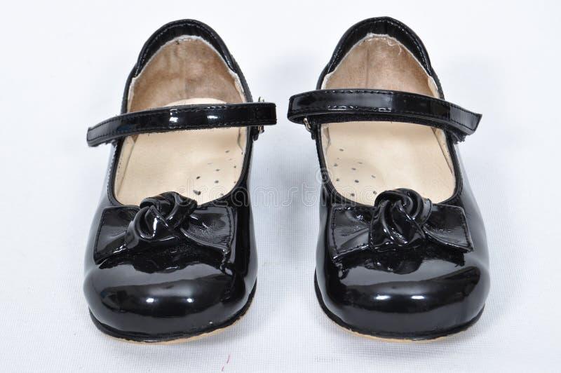 包括nubuck和皮革的女孩鞋子 免版税库存照片