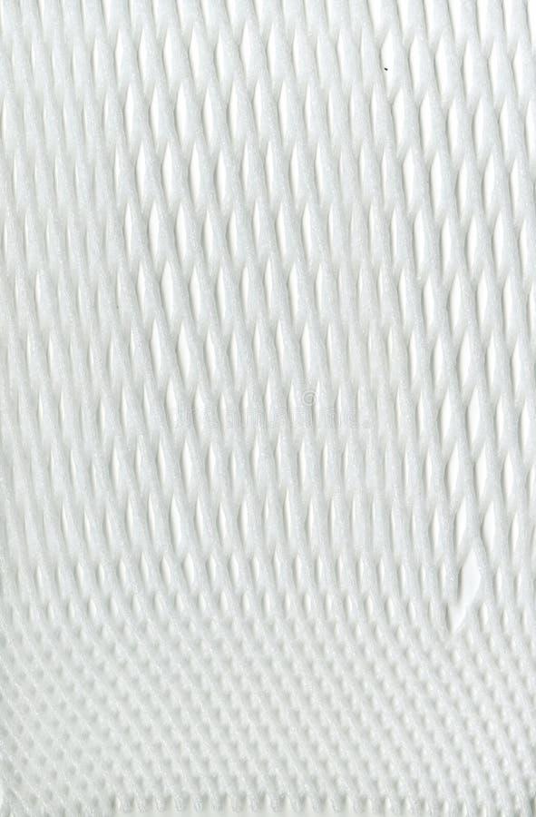 包装在黑背景的Textureof白色综合性滤网白色 尼龙白色宏观纹理样式背景 免版税库存照片