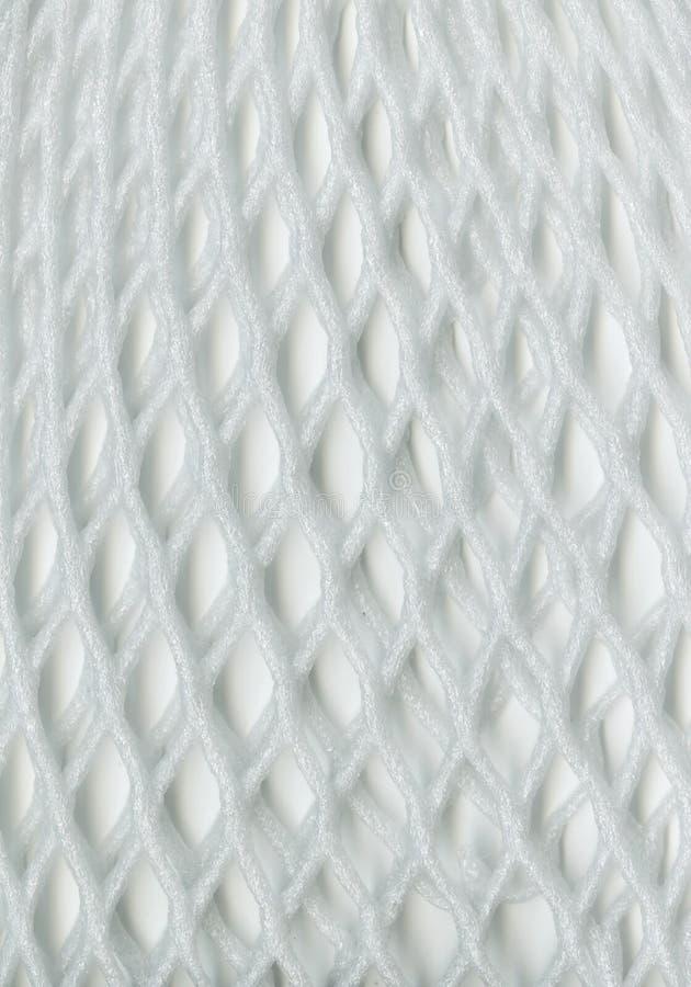 包装在黑背景的Textureof白色综合性滤网白色 尼龙白色宏观纹理样式背景 库存照片