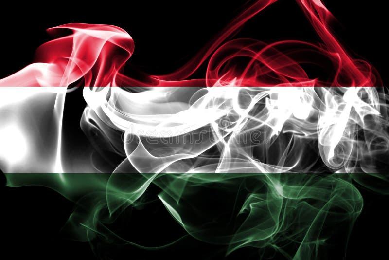 匈牙利的国旗由被隔绝的彩色烟幕做了在黑背景 免版税库存图片