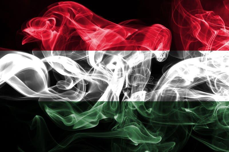 匈牙利的国旗由被隔绝的彩色烟幕做了在黑背景 图库摄影