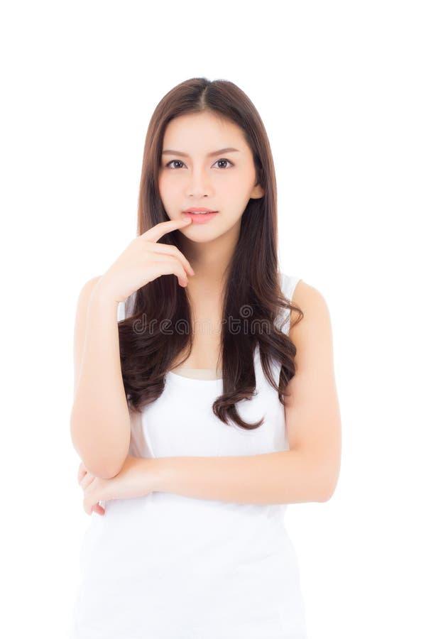 化妆用品、女孩手接触的嘴和的微笑,完善嘴唇的秀丽美好的亚洲妇女构成画象有吸引力  库存图片