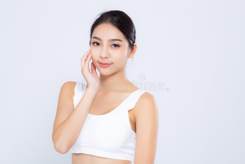 化妆用品、女孩手接触的面颊和的微笑,秀丽的面孔美女亚洲构成画象有吸引力  免版税库存照片