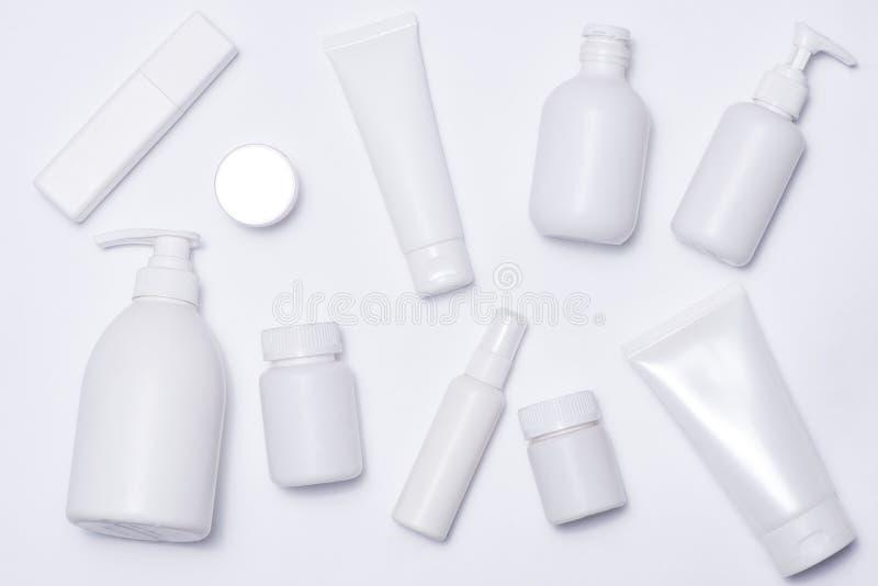 化妆用品温泉烙记的大模型,顶视图,在白色背景 库存照片