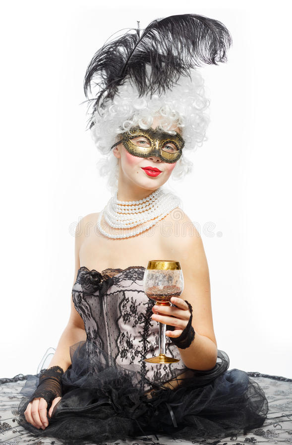 化妆舞会在威尼斯。一件黑礼服的公主 免版税库存图片