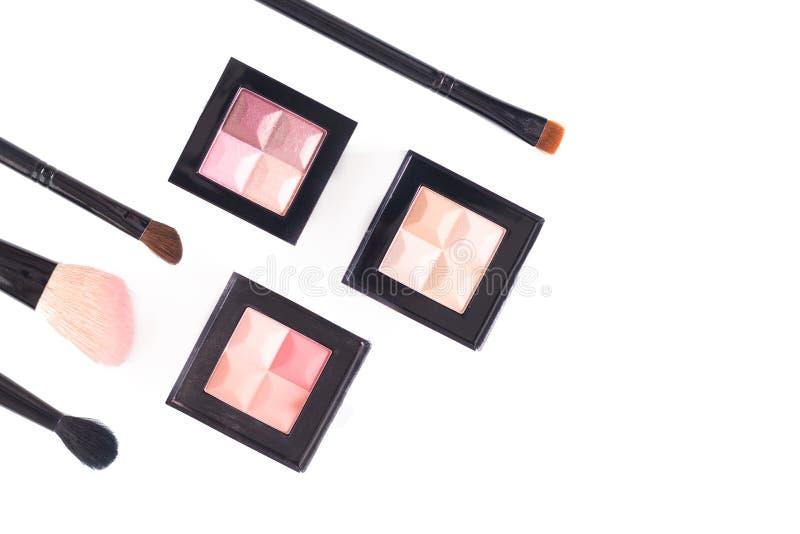 化妆调色板构成概念顶视图在轻淡优美的色彩的在与拷贝空间的白色背景 免版税图库摄影