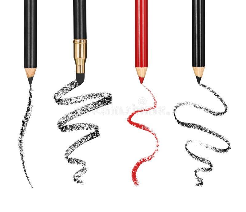 化妆铅笔和冲程的汇集 图库摄影