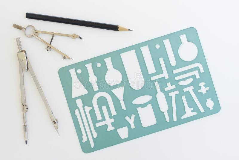 化学绘图仪器钢板蜡纸 免版税库存照片