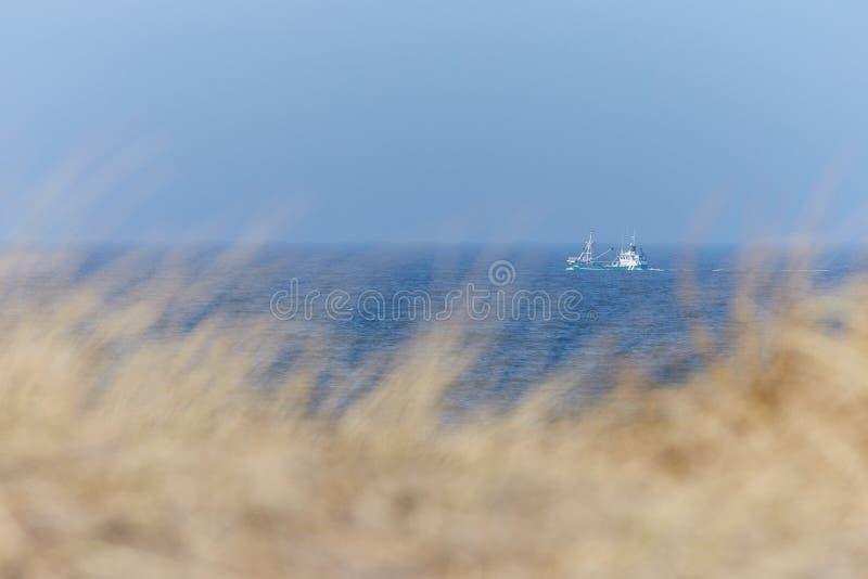 北海海岸在有渔船的丹麦 库存照片