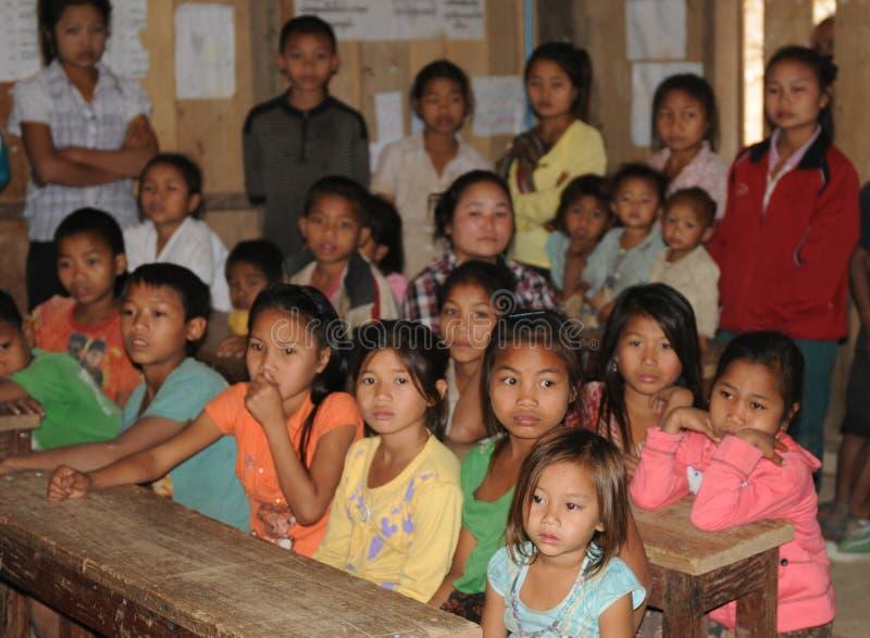 北部老挝:学童在湄公河村庄学校B 图库摄影