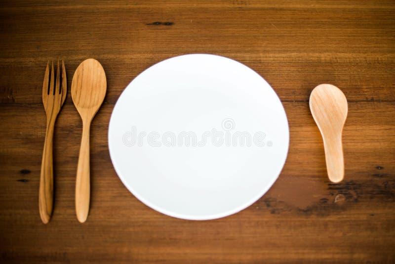 匙子、叉子和盘 免版税库存照片