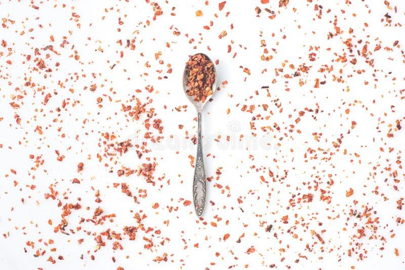 匙子用被磨碎的红辣椒 库存图片