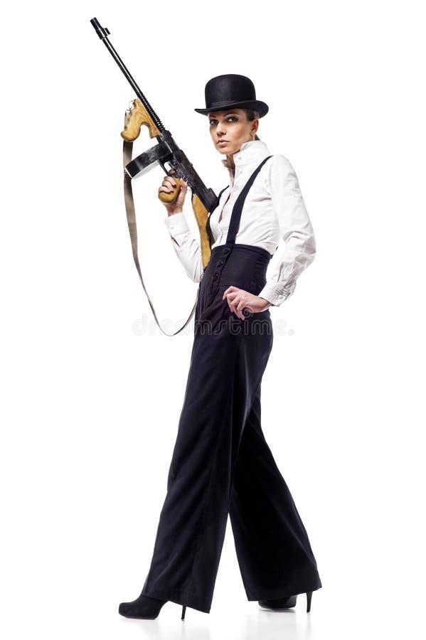 匪徒女孩枪藏品设备性感的汤普森 免版税库存图片