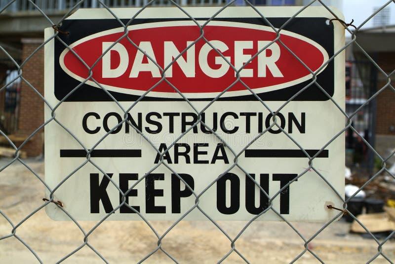 区建筑危险符号 免版税库存照片