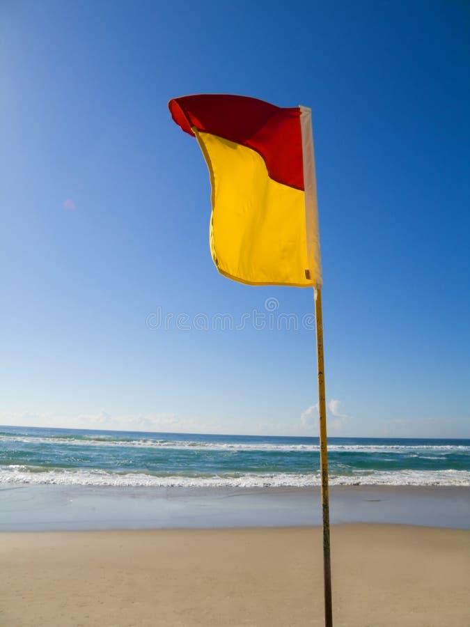 区aust海岸标志金昆士兰安全的游泳 免版税库存照片