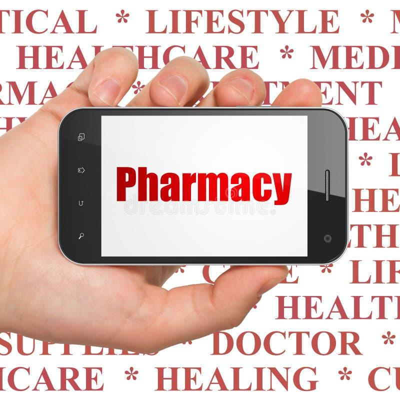 医学概念:拿着有药房的手智能手机在显示 免版税图库摄影
