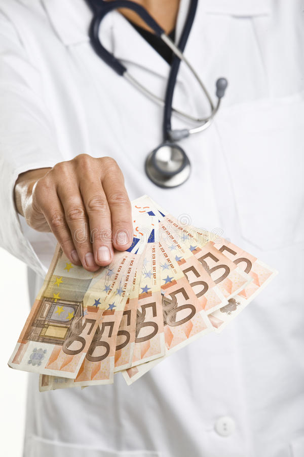 医生女性藏品货币 免版税库存照片