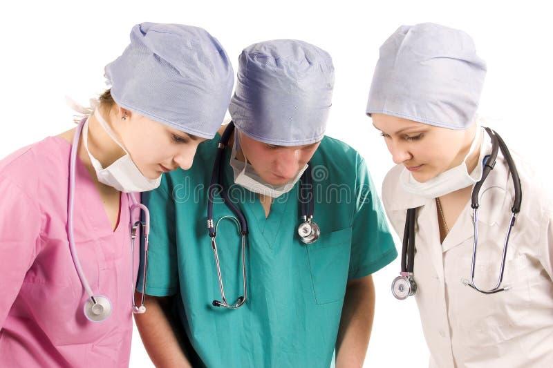 医生安置三工作 免版税库存图片