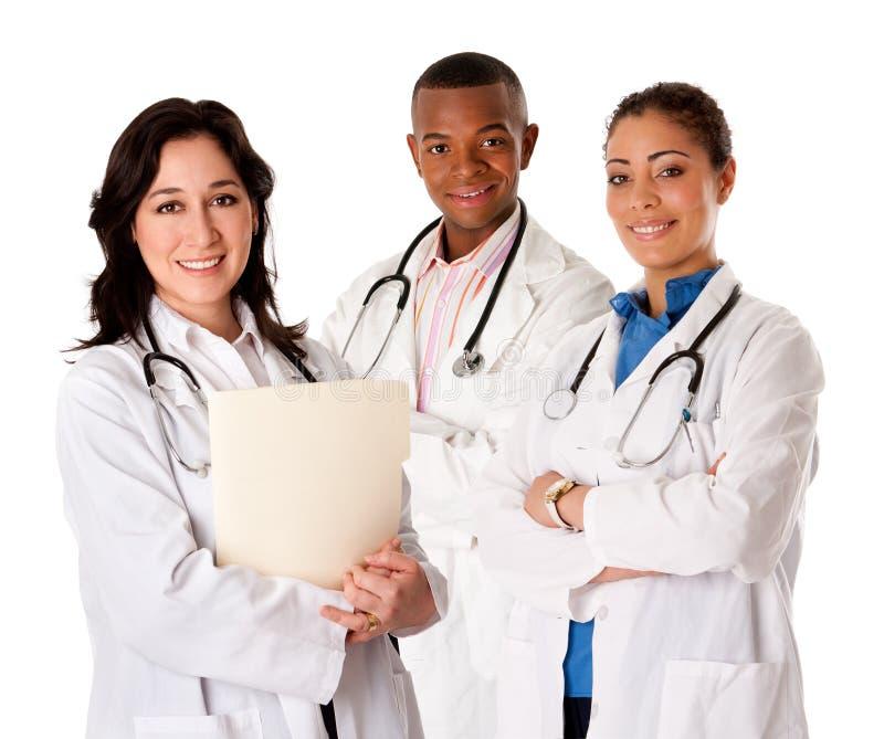 医生愉快的医师微笑的小组 免版税库存照片