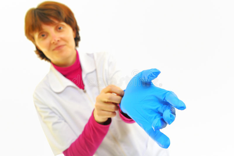 医生手套夫人乳汁年轻人 免版税图库摄影