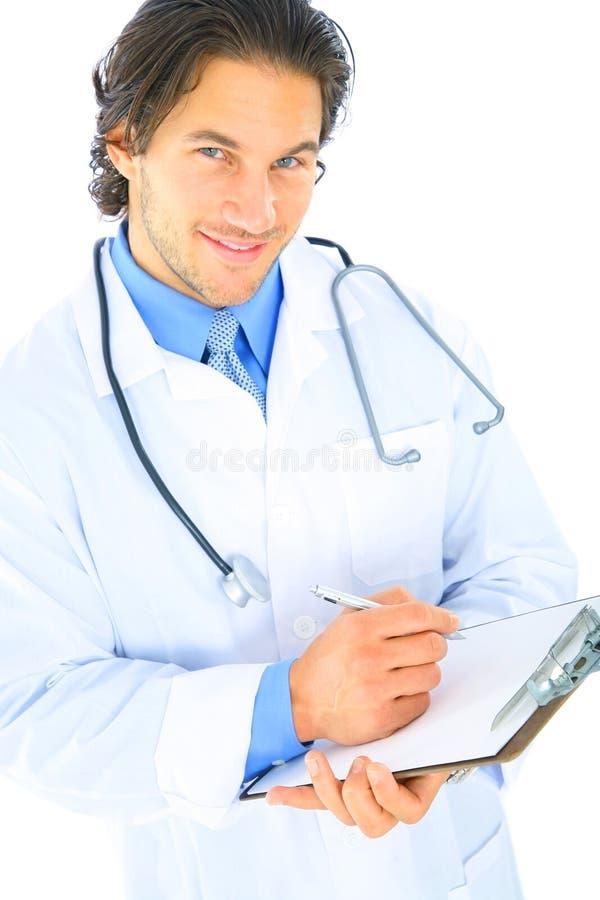 医生报表编写年轻人 免版税库存照片
