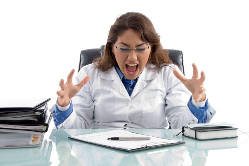 医生沮丧的工作场所 库存图片