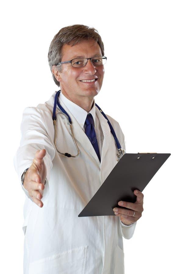 医生现有量信号交换医疗提供的微笑 库存照片