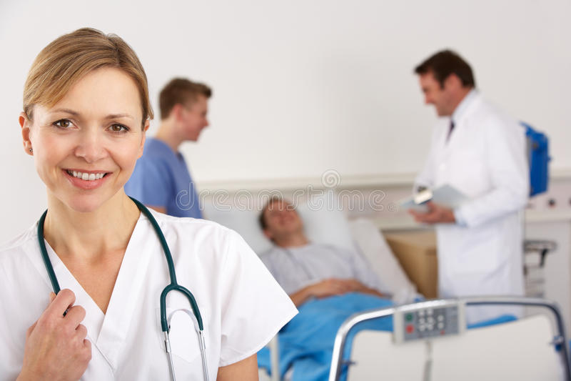 医生美国小组联系与患者 免版税库存图片