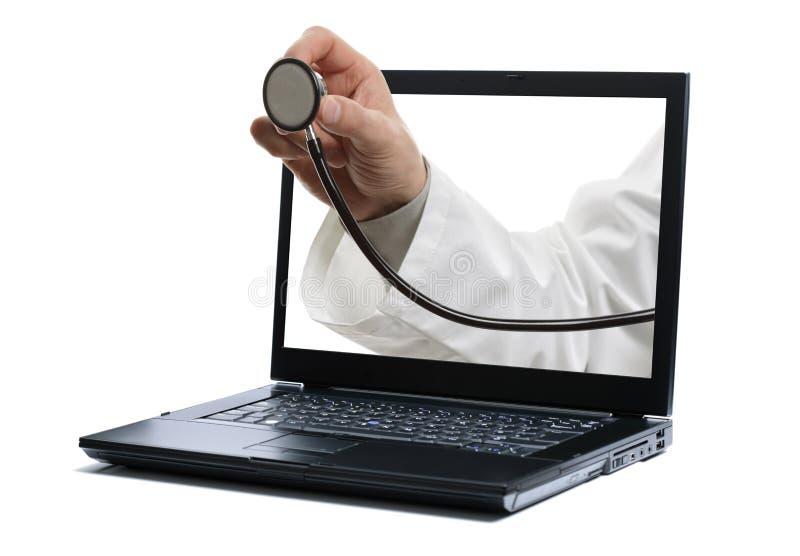 医生膝上型计算机听诊器 免版税库存图片
