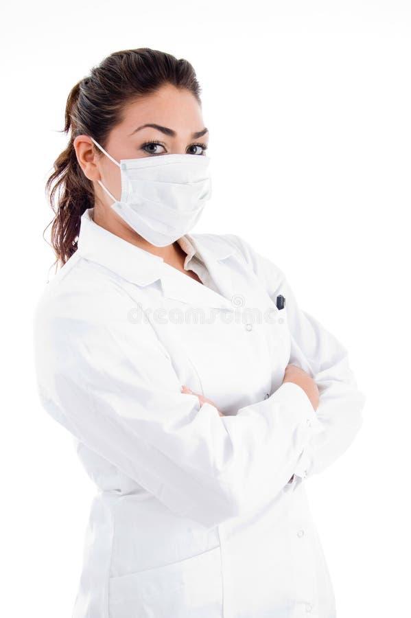 医生被折叠的现有量屏蔽姿势端 库存照片