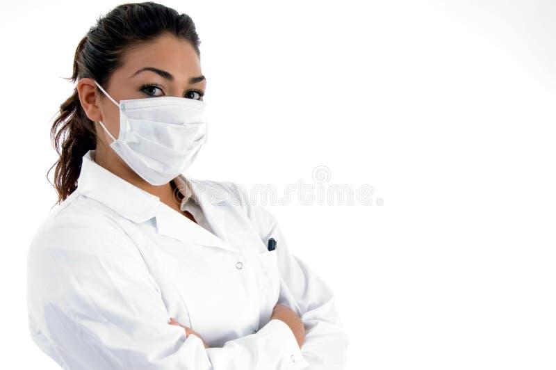 医生面对她的屏蔽侧视图 免版税库存图片