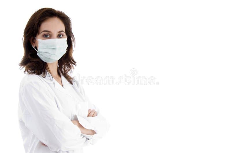 医生facemask姿势 免版税图库摄影