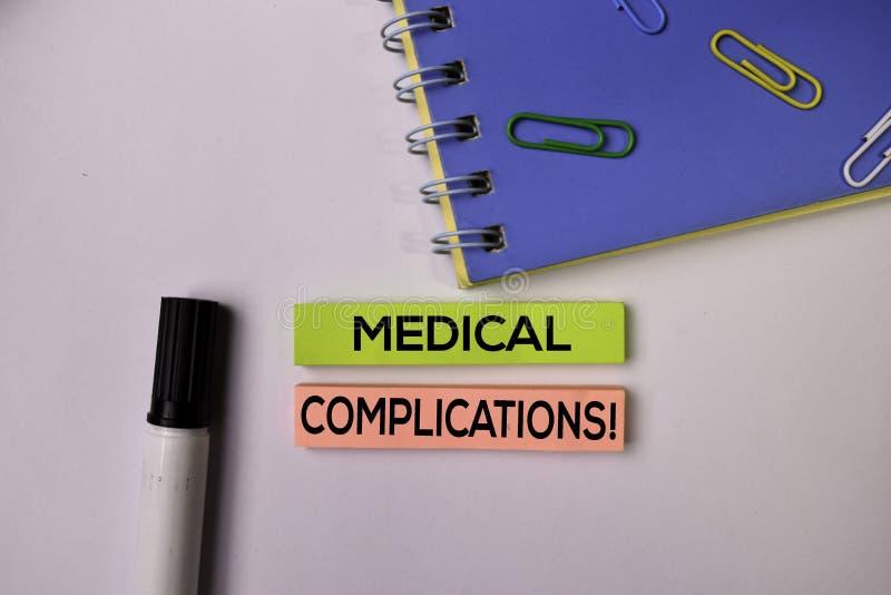 医疗复杂化!在白色背景隔绝的稠粘的笔记 图库摄影