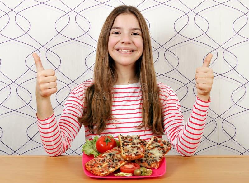 十几岁的女孩用三明治和赞许 库存图片