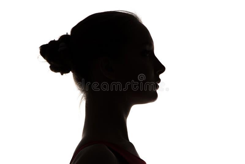 十几岁的女孩的头剪影  库存图片
