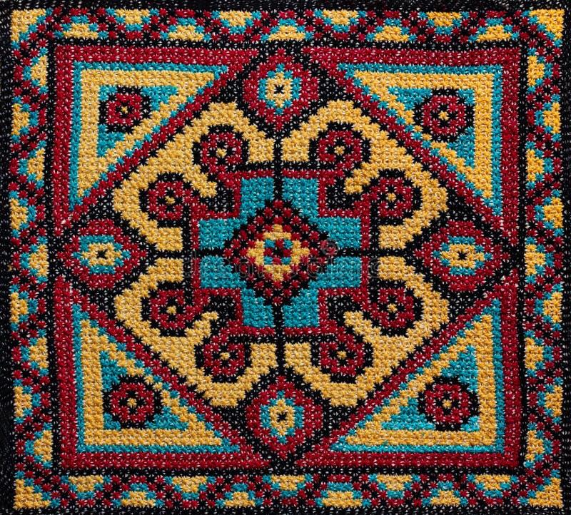 十字绣手工制造刺绣 圆的五颜六色的样式 免版税库存图片