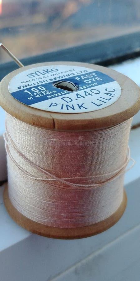 千福年的桃红色缝合针线葡萄酒 库存图片