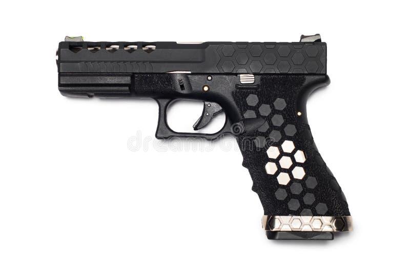 半在白色背景隔绝的自动9x19手枪,风俗 库存照片