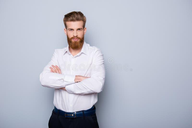 半外形画象严肃确信有胡子人保持 免版税图库摄影